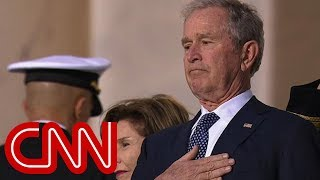 The emotional moment as Bush watches father's casket enter Capitol