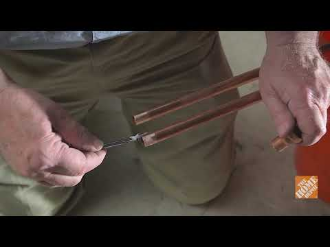 A man soldering copper pipes