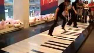 2 people Playing big Piano