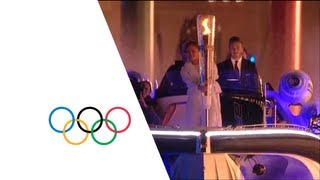 David Beckham & Sir Steve Redgrave Pass Olympic Torch - London 2012 Opening Ceremony