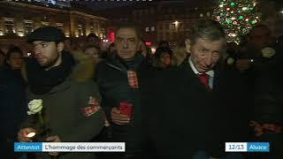 Hommage des commerçants du marché de Noël aux victimes du 11 décembre