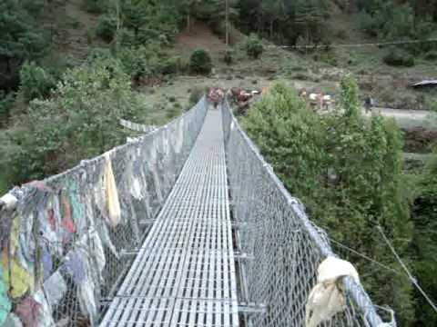 donkies w/bells cross suspension bridge by Phakding