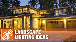 the yard of a house illuminated by landscape lighting