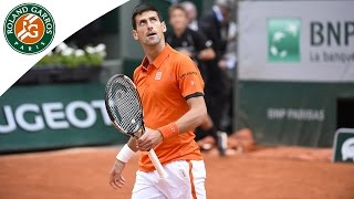 Novak Djokovic touches a ball before it bounces - 2015 French Open