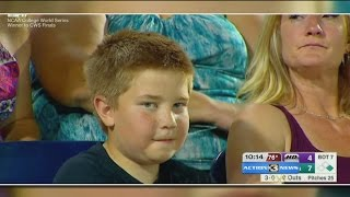 Omaha boy goes viral after stare down with ESPN at College World Series