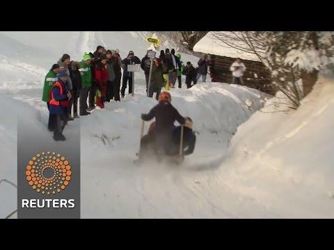 Bavarians race down snowy slopes on horned sleds