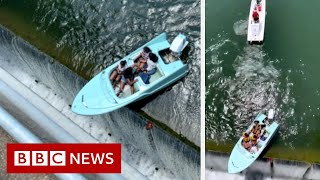 Boaters have a close call with a Texas dam - BBC News