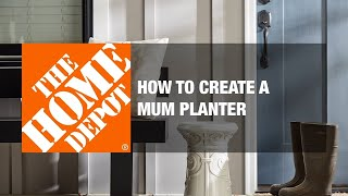 A video demonstrates how to make a mum planter.