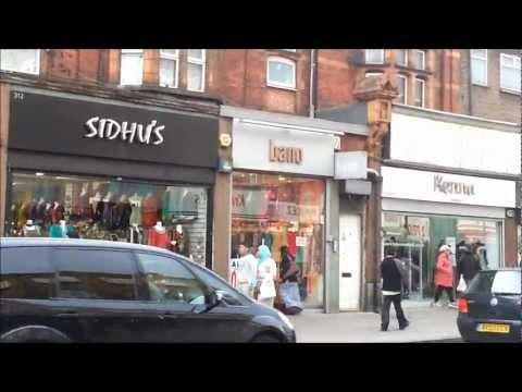 People shopping in Green Street Upton Park London UK