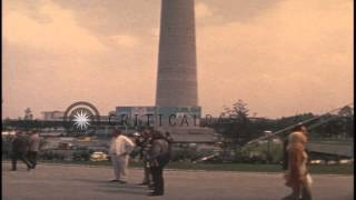 A crowd milling about outside the Olympic Stadium in Munich, Germany prior to the...HD Stock Footage