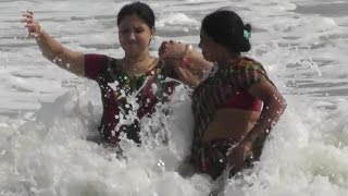Beautiful Tourist enjoying sea baths in Digha Sea Beach