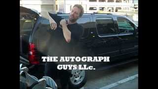 Chris Martin of Coldplay signing autographs as he strolls through LAX January of 2013.