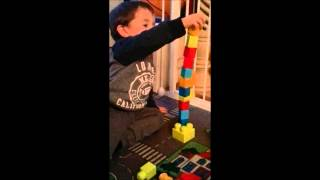Kid cries over falling blocks (mass over reaction)