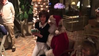 Deana Martin receives a gift from Santa Claus
