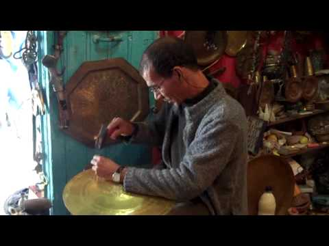 Crafting brass plates by hand in Chefchaouen, Morocco