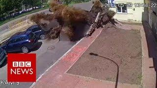 Dramatic Ukraine water pipe explosion captured on CCTV - BBC News