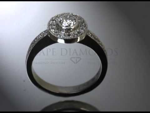 Complex stone ring,round diamond, small round diamonds in fitting,5 side stones,engagement ring