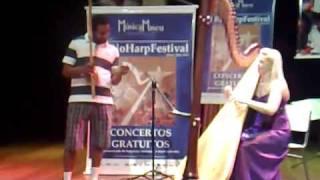 Museu de favela: Claire Jones royal harpist dueto with capoeira berimbau