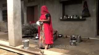 Women cook wearing ghungat or veils : Rajasthani village of Sonkhaliya width=