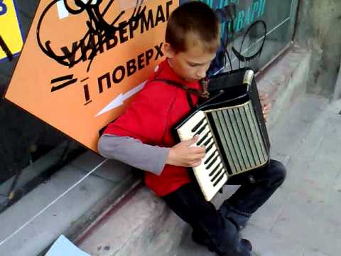 Kid playing accordion in Lviv street Ukraine