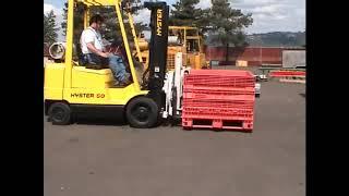 Atașament motostivuitor pentru rotirea și răsturnarea mărfurilor vrac (bulk box handler)