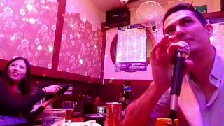 Guy singing right version of Chandelier at a Karaoke bar
