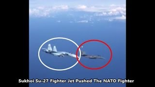 Russian Su-27 Forces Away NATO F-15 After It Approaches Of The Russian Federation Plane.