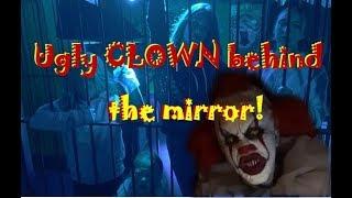 Clown behind the mirror maze!