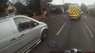 Are you blind its ambulance with blues and twos on move out the way.