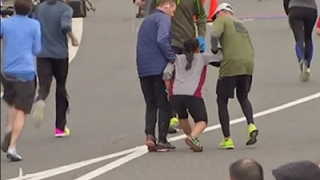 Raw: Exhausted Runner Helped to Finish Line