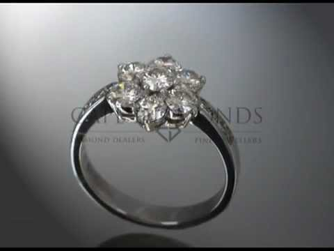 Organic ring design,flower shaped,8 round diamonds,4 round side diamonds,engagement ring