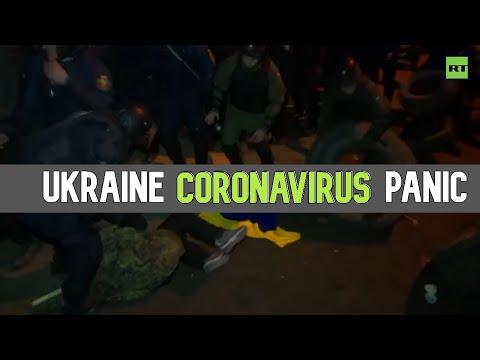 Riot police violently quash coronavirus quarantine protesters in a Ukrainian village