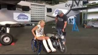 girl with both legs broken riding a minibike