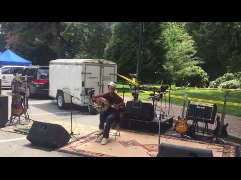 Farooq of MOSAIC plays oud at New Westminster welcome event
