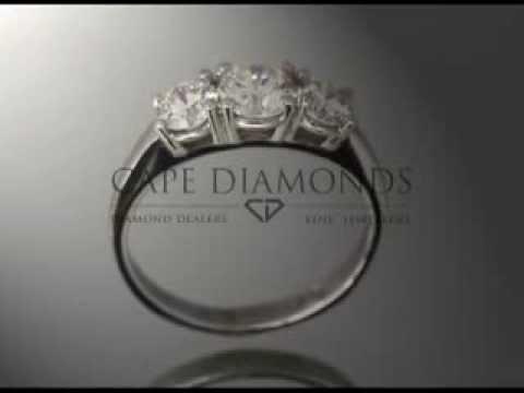 3 stone ring,round diamonds,middle stone bigger,platinum,engagement ring