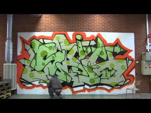 A wallpaper graffiti design is born at Photowall HQ - by graffiti artist Skil