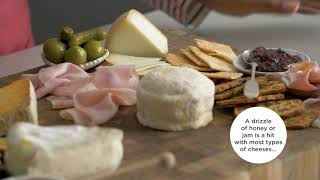A video demonstrates how to build a charcuterie board.