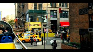 Royalty Free Stock Footage of People and cars moving by in New York City.