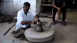 Making pottery in India