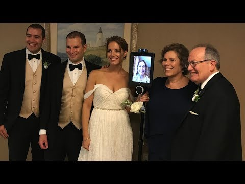 Maid of honor attends sister's wedding using a robot