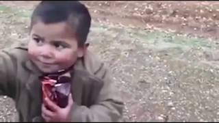 Turkish army man hands snacks to a little boy on Aleppo (english subtitled)