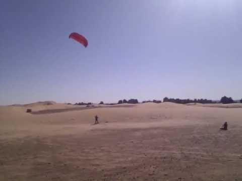 OurTour go kite flying in the Sahara dunes at Erg Chebbi, Morocco