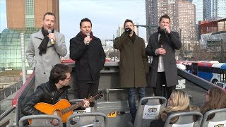 Watch 98 Degrees Surprise Tourists By Singing Christmas Carols