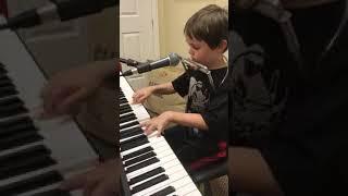 Piano, harmonica playing & singing kid