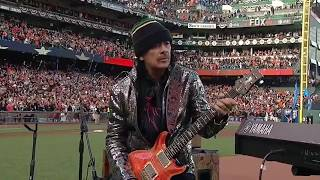 WS2014 Gm4: Carlos Santana and son perform anthem