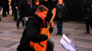 Musician at Wien plays Time to say goodbye on guitar