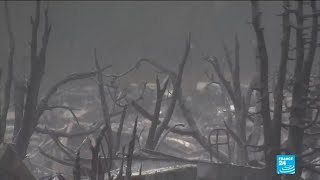 California wildfires: rain makes rescuers' work more difficult