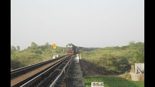 Nathdwara - Okha Express running 1 hour late passing through Rangmati Bridge [Jamnagar]
