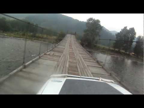 dangerous road suspension bridge. Extreme Russia