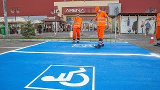 Road markings for parking spaces, applied with 2K Cold-Plastic and preformed thermoplastic